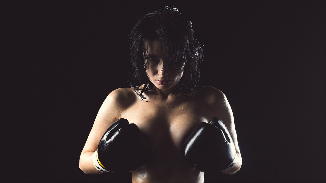 Topless Woman with Boxing Gloves